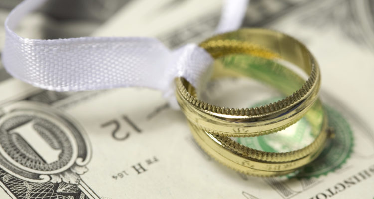 wedding ring and money